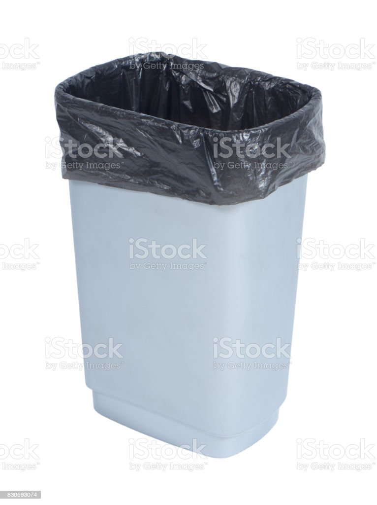 Empty trash container with black plastic bag on white background royalty-free stock photo