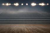 Empty tribune with spotlights on the gym