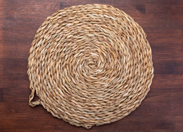 empty trivet of natural fibers. on dark wood background. concept to include your food and your text. - sisal stock pictures, royalty-free photos & images