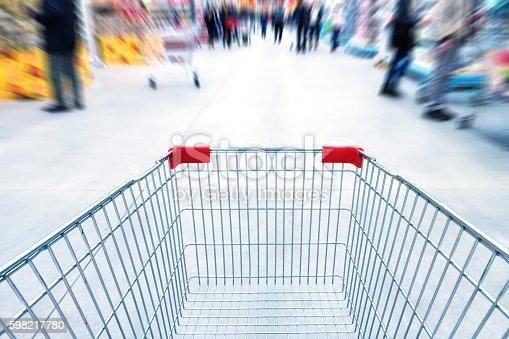 511190632 istock photo Empty trolley in supermarket 598217780