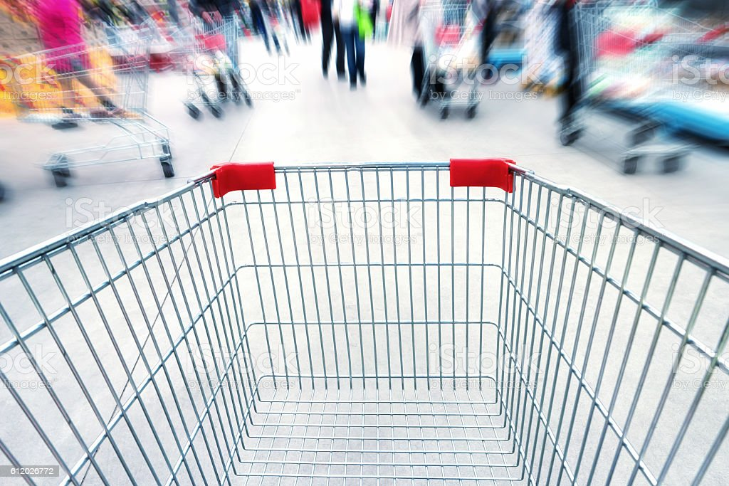 Empty trolley in supermarket stock photo