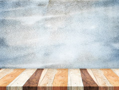 593305530 istock photo Empty tropical Wooden Table top at grunge blue stone wall 482655088