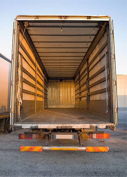 empty truck - lorries unloading stock photos and pictures