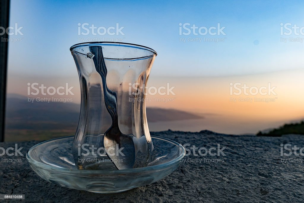 Empty turksih traditional tea glass on a wonderful scenary stock photo