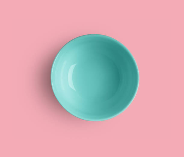 Empty turquoise bowl on pink with clipping path stock photo