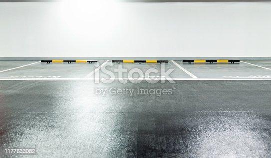 Empty underground parking garage in modern building.