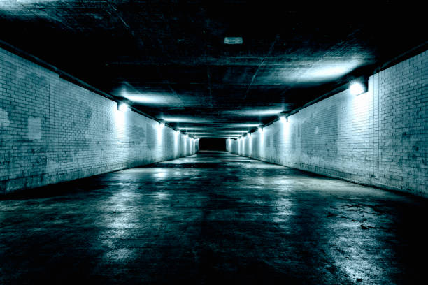 Empty underground tunnel at night stock photo