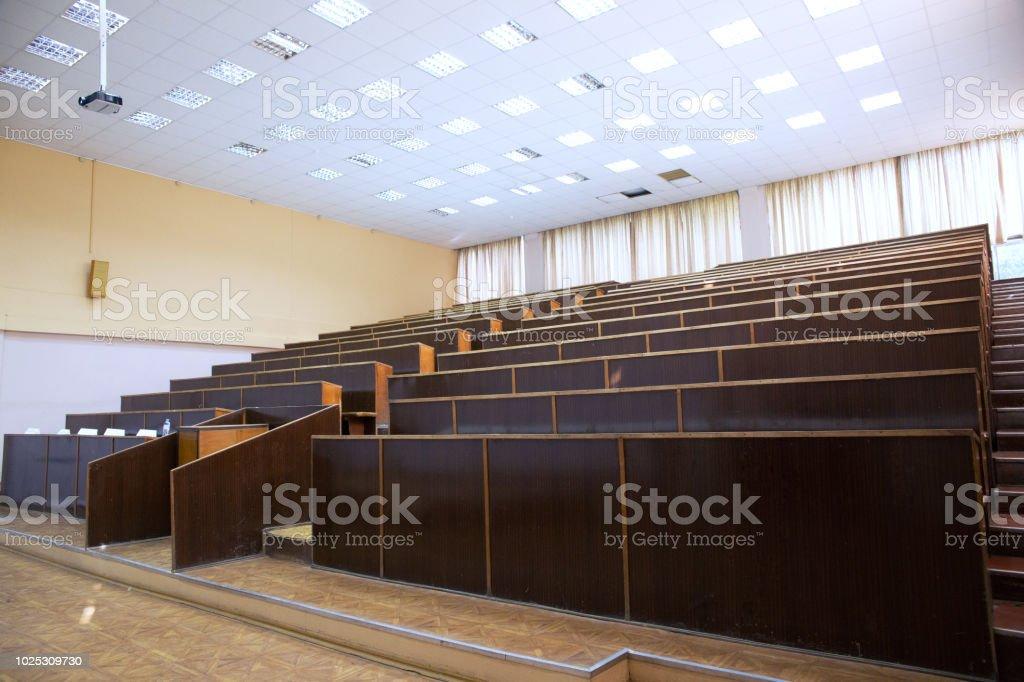 Empty university Auditorium filled with sunlight.