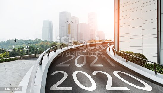 1150191246 istock photo Empty uphill highway with Number 2019, 2020, 2021 1150193027