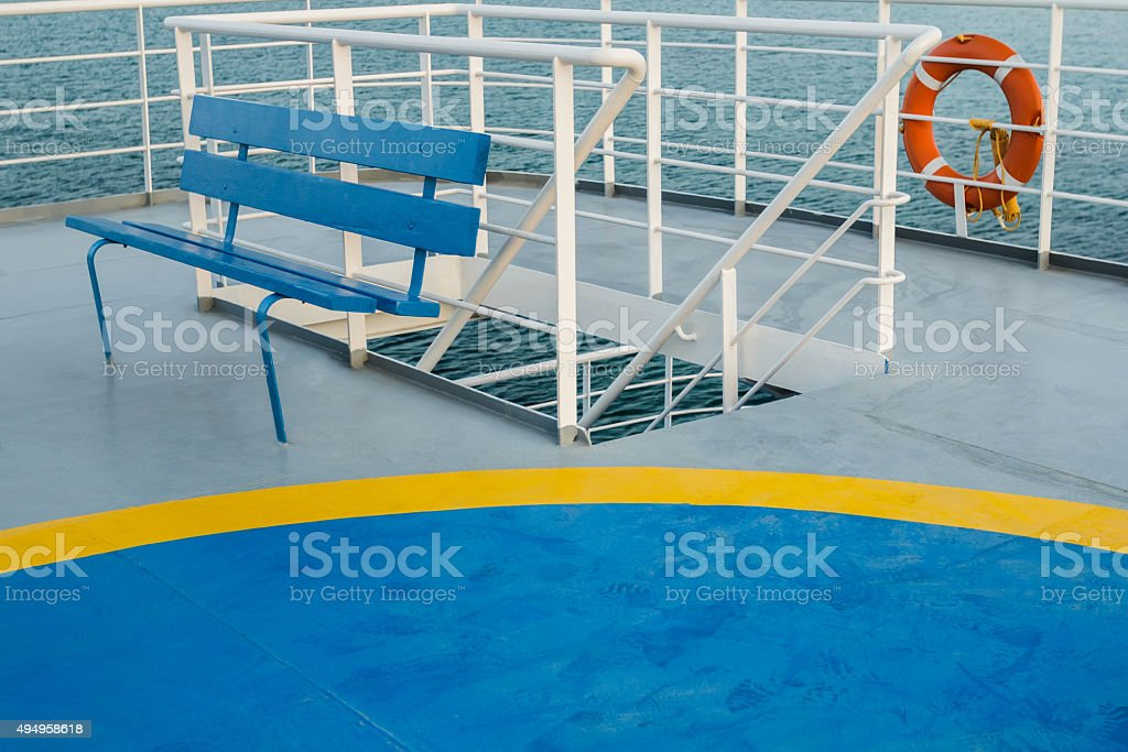 Empty upper deck with blue bench and helicopter pickup point stock photo