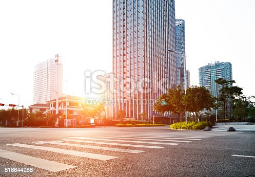 istock Empty urban road and office buildings 816644288