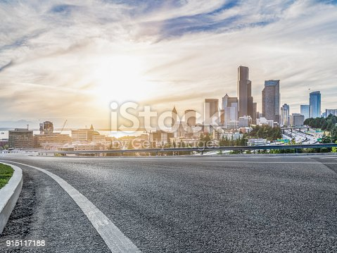 istock empty urban road travel through modern skyscrapers of Seattle 915117188
