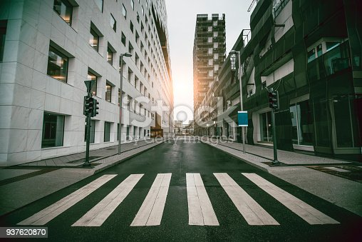 Empty Urban Street with Skyscraper at Sunrise