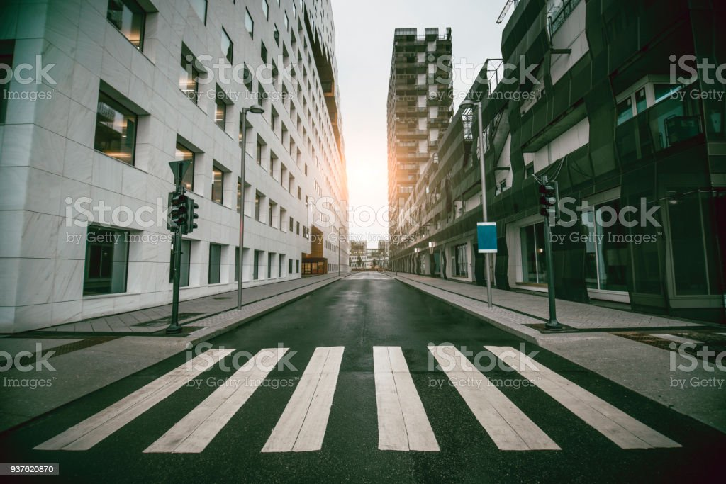 Empty Urban Street with Skyscraper at Sunrise stock photo