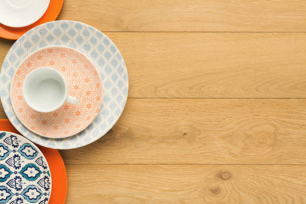 empty vintage plates and coffee cup on natural wood, top view - crockery stock photos and pictures