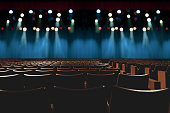 istock empty vintage seat in auditorium or theater with lights on stage. 1001928116