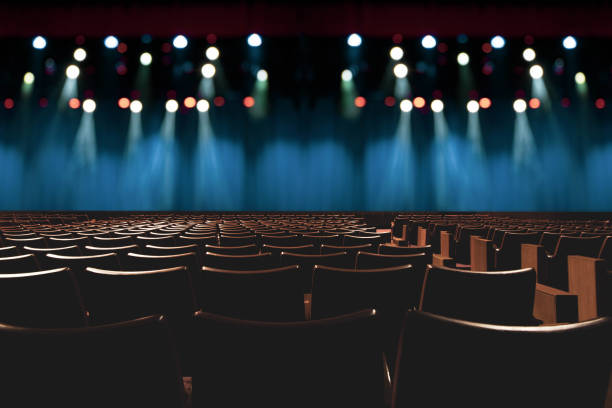 empty vintage seat in auditorium or theater with lights on stage. empty vintage seat in auditorium or theater with lights on stage. performing arts event stock pictures, royalty-free photos & images