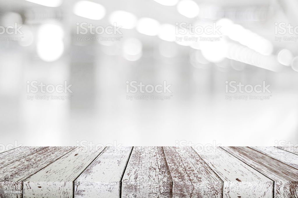 Empty Vintage White Wood Table Over Blur Store Background, Perspective  Wooden Board Background For Product