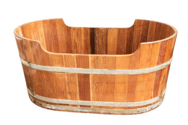 empty vintage wooden bathtub isolated on white background. - bacinella metallica foto e immagini stock