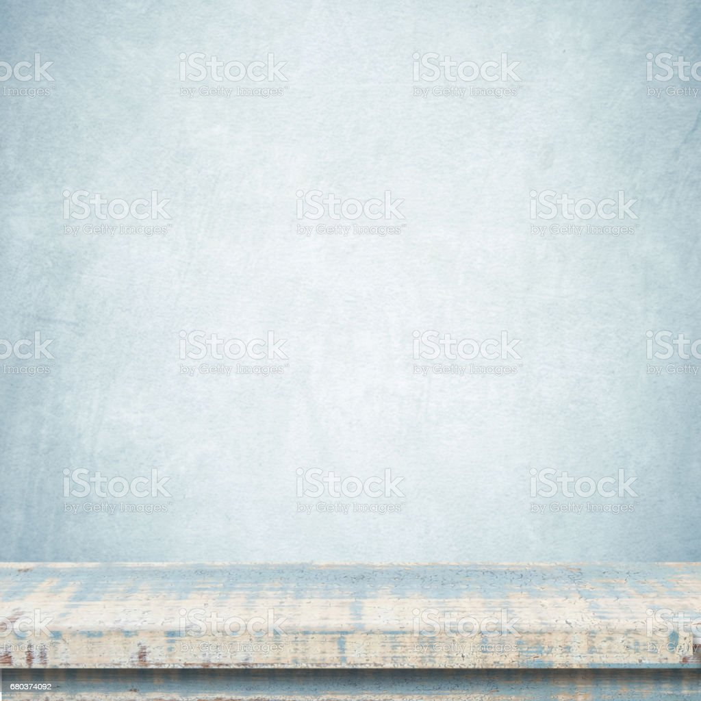 Empty vintage wooden table over blue cement wall background, template, product display montage royalty-free stock photo