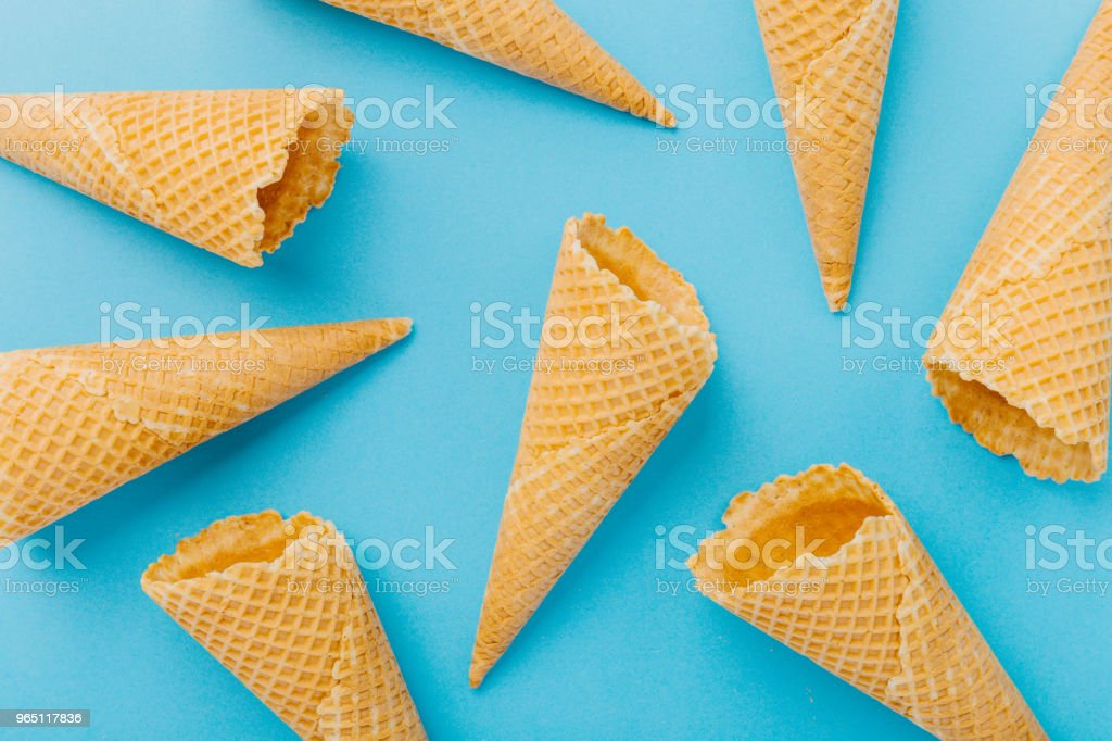 Empty waffle cones on blue background royalty-free stock photo