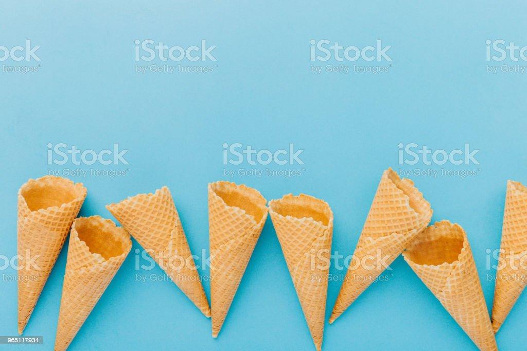 Empty waffle cones on blue background royalty-free stock photo