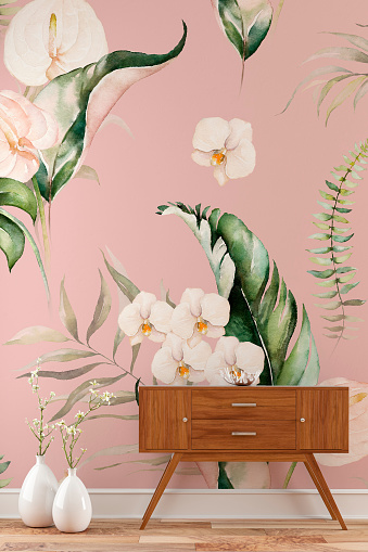 Empty tropical flowers and leaves wallpaper background with a console table on the right and decoration on hardwood floor with copy space. 3D rendered image.
