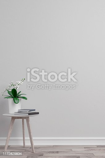 Empty gray plaster wall background on hardwood floor with copy space and decoration. Slight vintage effect added. 3D rendered image.