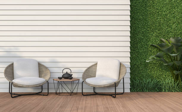 Empty wall exterior with white wood plank 3d render Empty wall exterior 3d render,There are white wood plank wall and wooden floor,decorate with rattan lounge chair, decorate wall with green plant. courtyard stock pictures, royalty-free photos & images