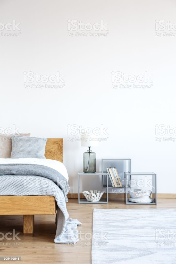 Empty wall in simple bedroom stock photo
