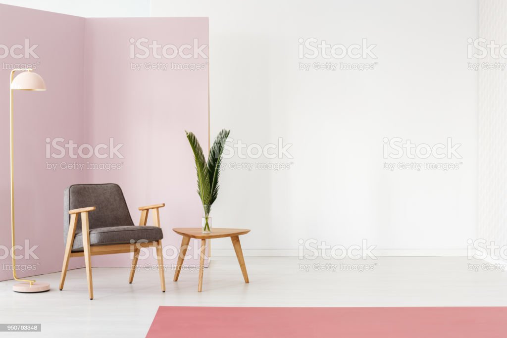 Empty wall next to armchair stock photo
