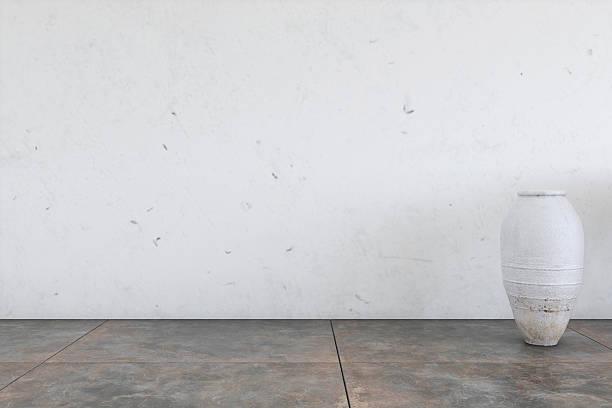 leere wand mit einer vas'auf der rechten seite am ende - betonboden wohnzimmer stock-fotos und bilder