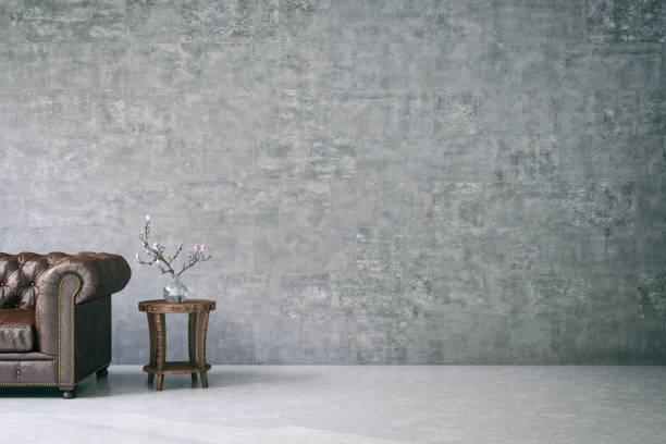 leere wand mit leder-sofa - tischsofa stock-fotos und bilder