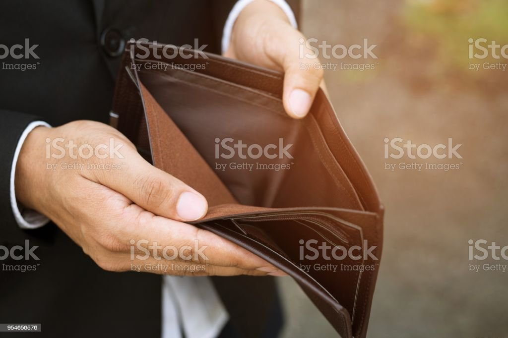 Empty wallet in the hands of an businessman. High cost of living in...