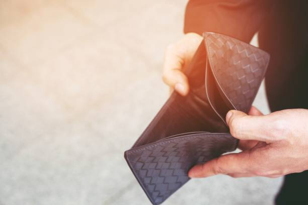 Empty wallet (no money) in the hands of an businessman. Empty wallet (no money) in the hands of an businessman. High cost of living in city Cost control expenses poverty in concept. empty wallet stock pictures, royalty-free photos & images