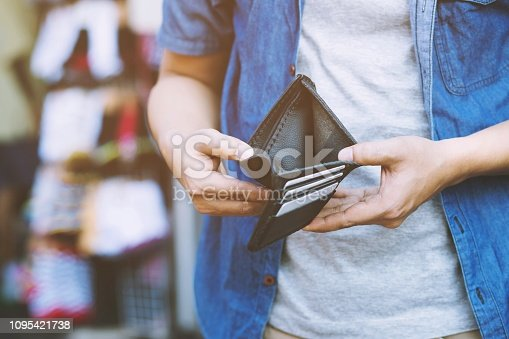 istock Empty wallet (no money) in the hands of an man. Cost control expenses poverty in concept 1095421738