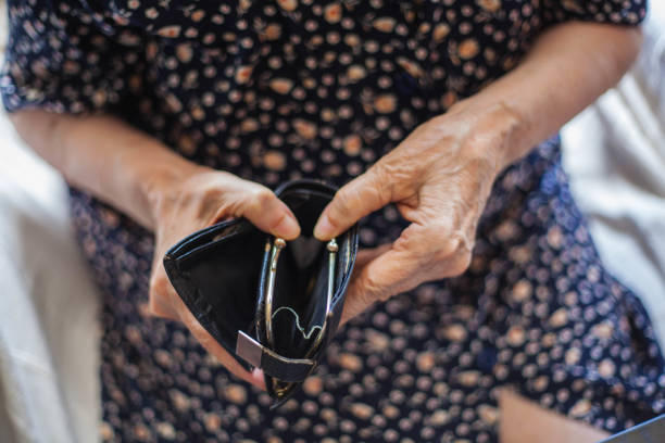 Empty wallet. Close up photo of old woman hands holding empty wallet. empty wallet stock pictures, royalty-free photos & images