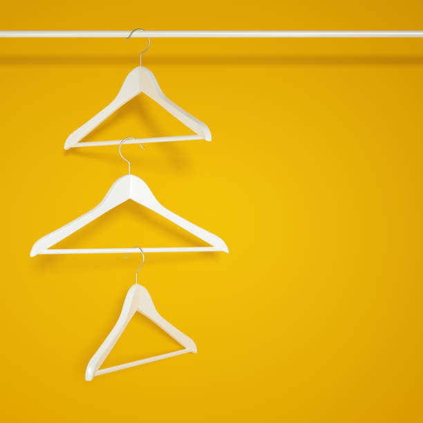 Empty Wardrobe and hanging clothes hangers Empty Wardrobe and hanging clothes hangers on yellow background, nothing wear concept. 3d rendering coathanger stock pictures, royalty-free photos & images