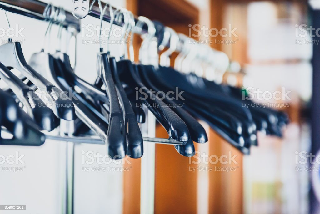 empty closet with hangers. Empty Wardrobe Stand With Black Hangers At Business Event Venue. Royalty-free Stock Photo Closet