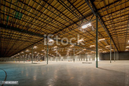 Large empty warehouse interior.