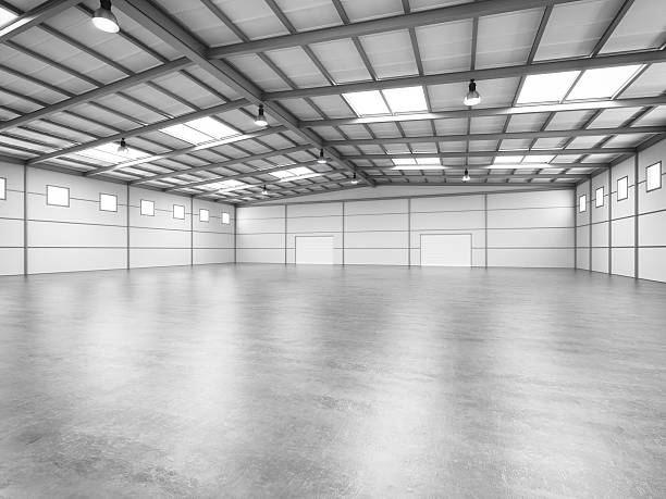 Empty Warehouse Interior of an empty modern warehouse. airplane hangar stock pictures, royalty-free photos & images