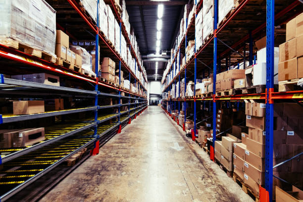 Empty warehouse with pallets and boxes stock photo