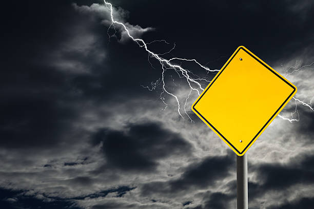 empty warning sign against cloudy and thunderous sky - extreme weather stock pictures, royalty-free photos & images