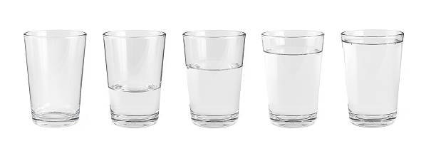 Empty water glass and one glass of water ストックフォト