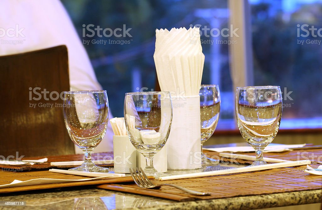 empty water glass on table stock photo