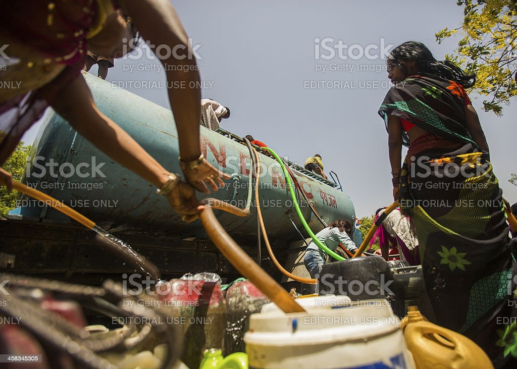 Empty water jugs are filled  on side of road stock photo