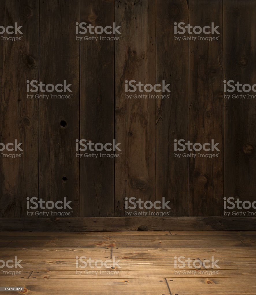 Empty Western Barn wood wall with plank floor spotlit stock photo