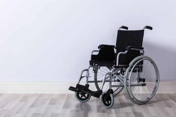 empty wheelchair in room - wheelchair stock photos and pictures
