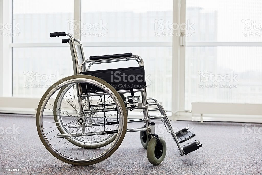 Empty wheelchair in the hospital hall royalty-free stock photo