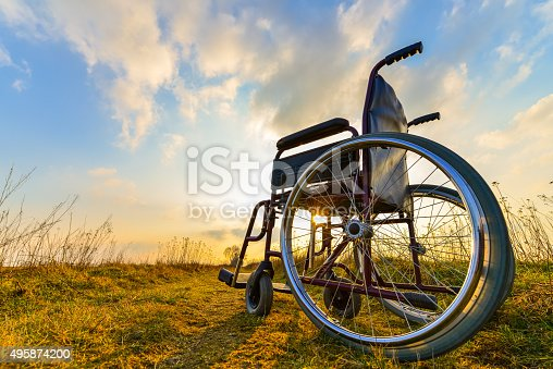 Empty Wheelchair On The Meadow At Sunset Stockfoto en meer beelden van 2015